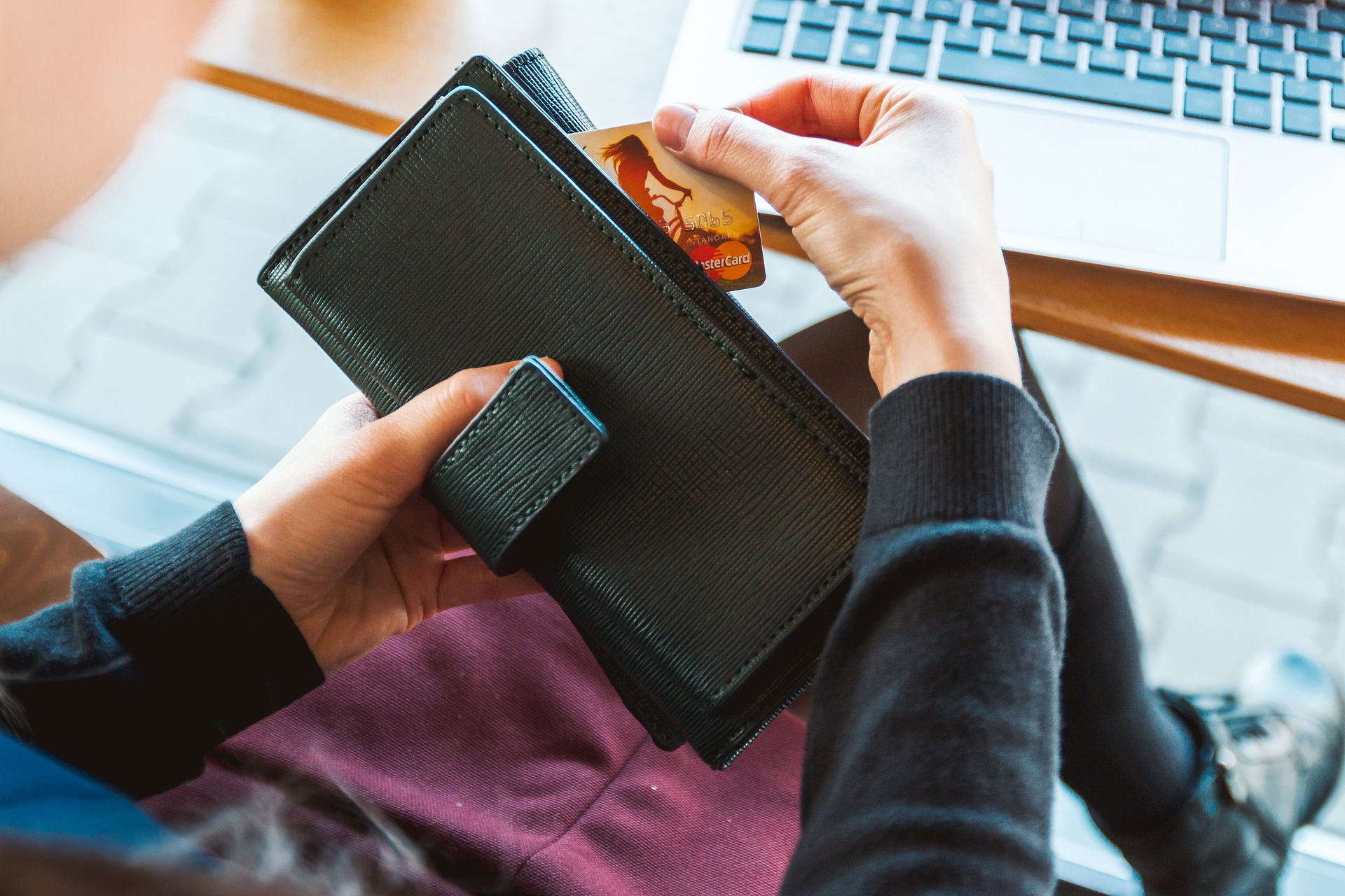 A woman removing a credit card from her wallet